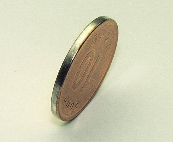 Рис. 6. Гурт (боковая образующая) южнокорейской монеты (10 вон, 2009)