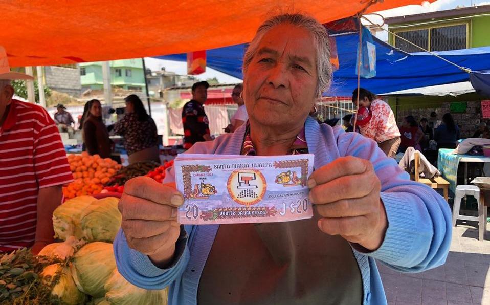 Рис. 7. Санта-Мария-Хахальпа, местная жительница на рынке. Vía México